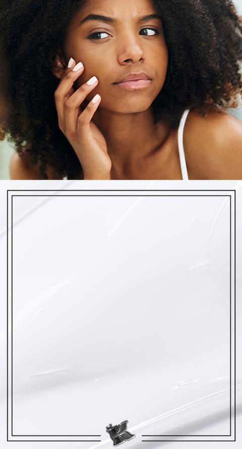 A woman toucher her face