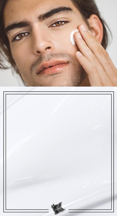 A man rubbing a cream into his face