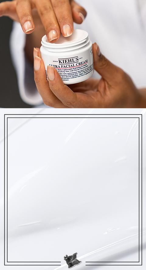 A woman rubbing her fingers into Kiehl's Ultra Facial Cream.