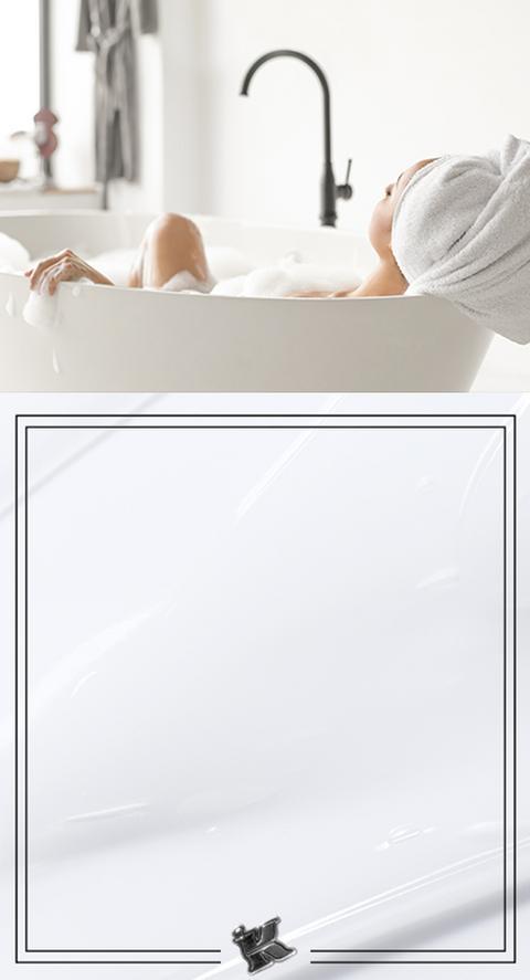 A woman lounging in a bathtub
